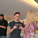 Judge and Executive Chef, Shane Devereux of Top Flr looks on as Tyler Nelson and Arianne Fielder toast their success.
