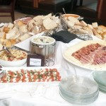 A delicious spread of fresh bread, caprese salad, prosciutto, cheese, and much more for noshing!