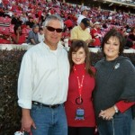 Katy Ruth with her daddy & mama on Game Day.