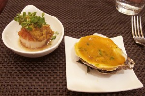 Seared scallop topped w/ a fried oyster & red curry sauce