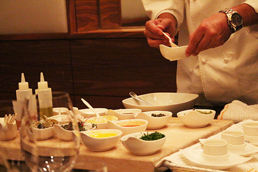 Chef Nick prepares steak tartare table-side at BLT Steak.