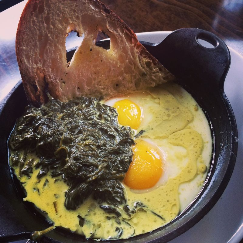 Skillet eggs with creamed spinach and toast.