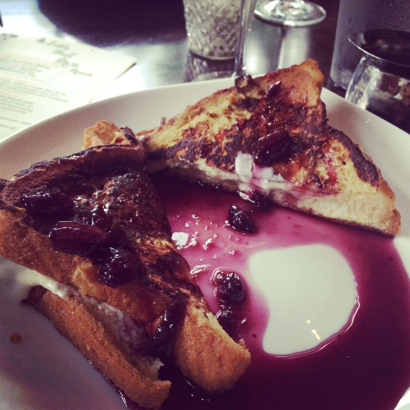 French toast stuffed with mascarpone cheese topped with blueberry syrup.